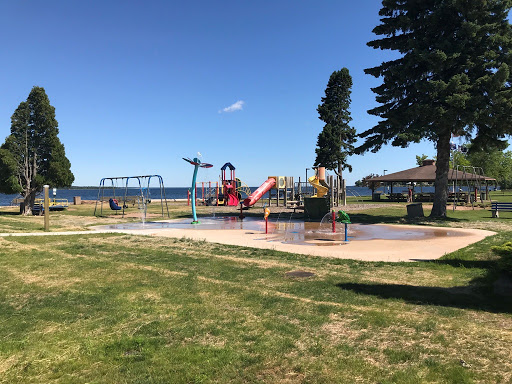 Children play at on the splash pad.